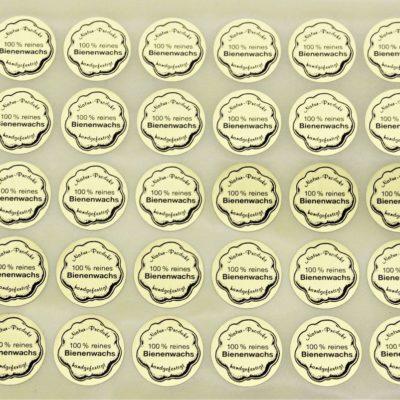"""Aufkleber """"Natur Produkt – 100% reines Bienenwachs – handgefertigt"""" klein 19 mm"""